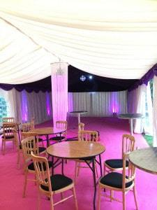 Bold colours and disco ball in party marquee